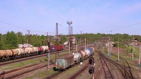 Long freight train rides on railway stock video footage