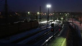 Long freight trains move on railway at night. Long freight trains move on railway at winter night stock video footage