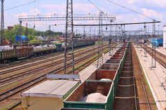 Long freight trains are on railways near station Stock Photo