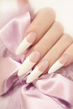 Long French manicure. Royalty Free Stock Photo