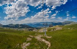 Long Funiculars ropeway line in Scenic Mountains Royalty Free Stock Images