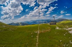 Long Funiculars ropeway line in Scenic Mountains Stock Photography