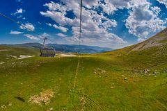 Long Funiculars ropeway line in Scenic Mountains Stock Photos