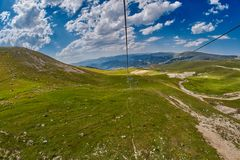 Long Funiculars ropeway line in Scenic Mountains Stock Images