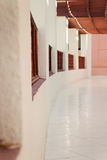 Long gallery corridor with columns in perspective Stock Photo
