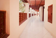 Long gallery corridor with columns in perspective.  Stock Image