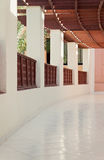 Long gallery corridor with columns in perspective Royalty Free Stock Photos