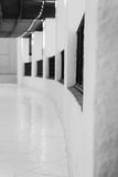 Long gallery corridor with columns in perspective in black and w Stock Photography