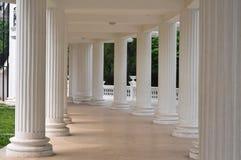 White pillars. A long gallery and White pillars Stock Photo