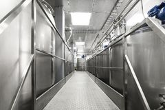 A long gangway between two rows of cisterns. Storage of food liquids. Royalty Free Stock Images