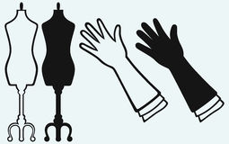 Long glove and tailor's mannequin Stock Photo