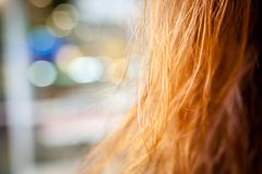 Long gold hair on bokeh background Royalty Free Stock Image