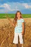 Long golden hair girl in wheat field Stock Photos