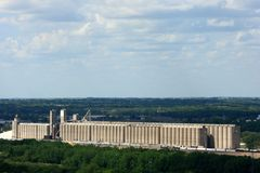 A Long Grain Elevator Surrounded By Trees Royalty Free Stock Photos