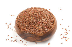 Long-grain red rice on white Stock Images