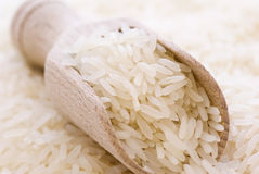 Long Grain Rice. With wooden spoon Royalty Free Stock Photo