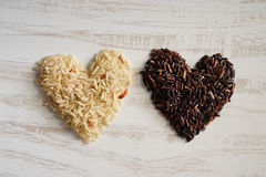 Long grain rice,brown rice, healthy concept. Royalty Free Stock Image