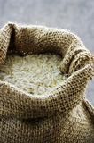 Long grain rice in burlap sack Stock Photos