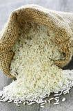 Long grain rice in burlap sack Royalty Free Stock Photos