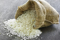 Long grain rice in burlap sack Royalty Free Stock Photography