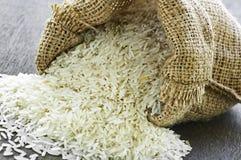 Long grain rice in burlap sack Stock Image