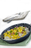 Long-grain rice with scrambled eggs and bacon Stock Images