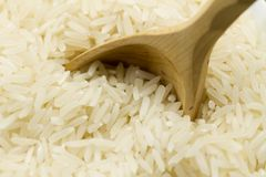 Long grain rice with a wooden spoon Royalty Free Stock Photography