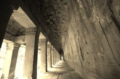 Long gray corridor with light at the end of.  Stock Photos