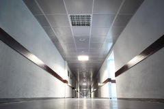 Long gray hallway with doors Royalty Free Stock Photos