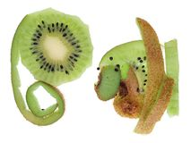 Long green an haired brown skins from peeled ripe kiwi apteryx fruit isolated. Long green an haired brown skins from peeled ripe kiwi apteryx fruit. Isolated on stock photos