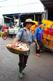 The man carry fish basket at fishing market. LONG. The man with tired face carry fish basket into fishing market in vertical frame. July 15, 2013 Royalty Free Stock Photography