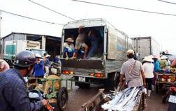 Traffic jam at fishing market. LONG HAI, VIET NAM-. Many vehicles as trucks, motorbikes, tricycles, rickshaws go into fishing market make trafiic jam, crowded Royalty Free Stock Images