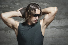 Long hair athlete with green tank top. Long hair athlete is wearing green tank top and sunglasses Royalty Free Stock Images