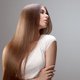 Long Hair. Beautiful Woman with Healthy Brown Hair.