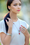 Long hair beautiful woman. Model with luxury accessory and jewel Royalty Free Stock Photos