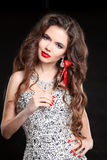 Long hair. Beautiful woman with Red lips, manicured nails. Brune Stock Photography