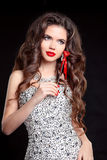 Long hair. Beautiful woman with Red lips, manicured nails. Brune Royalty Free Stock Image