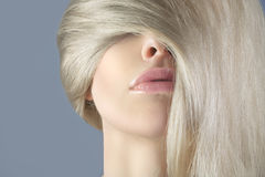Long hair blonde in the face of a woman. Sensual woman with long hair blonde Royalty Free Stock Image