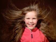 Long hair blowing in the wind. 8 Year old girl with very long hair Stock Images