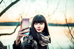 Long hair brunette gir making selfie photo royalty free stock images