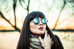 Long hair brunette gir in sunglasses outdoor royalty free stock image