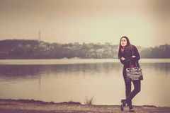 Long hair brunette girl outdoor with lake behind Royalty Free Stock Photography
