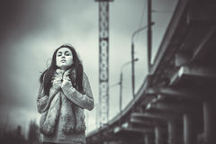 Long hair brunette girl outdoor with old industrial bridge behin Royalty Free Stock Photo