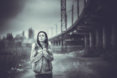 Long hair brunette girl outdoor with old industrial bridge behin Royalty Free Stock Images