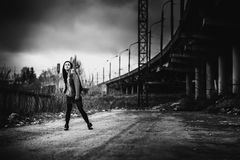 Long hair brunette girl outdoor with old industrial bridge behin Stock Photos