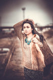 Long hair brunette girl outdoor with old industrial view behind, grain effect Royalty Free Stock Image