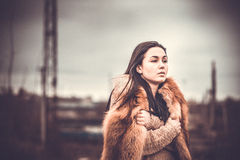 Long hair brunette girl outdoor with old industrial view behind, grain effect Stock Photos