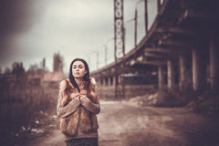 Long hair brunette girl outdoor with old industrial view behind, grain effect Royalty Free Stock Photos