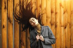 Long hair brunette woman outdoor in the park stock photography