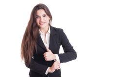 Long hair business woman adjusting suit sleeve Stock Photos